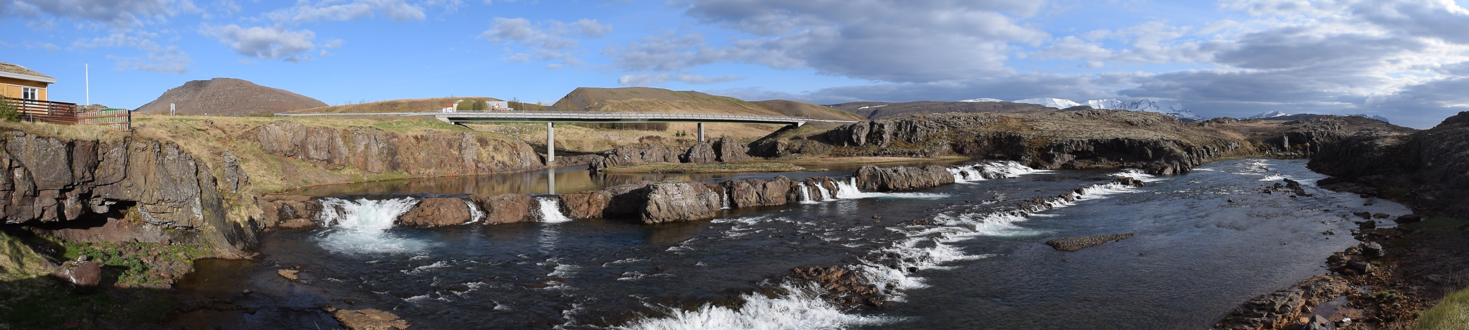 Photo of waterfalls and a bridge in Iceland