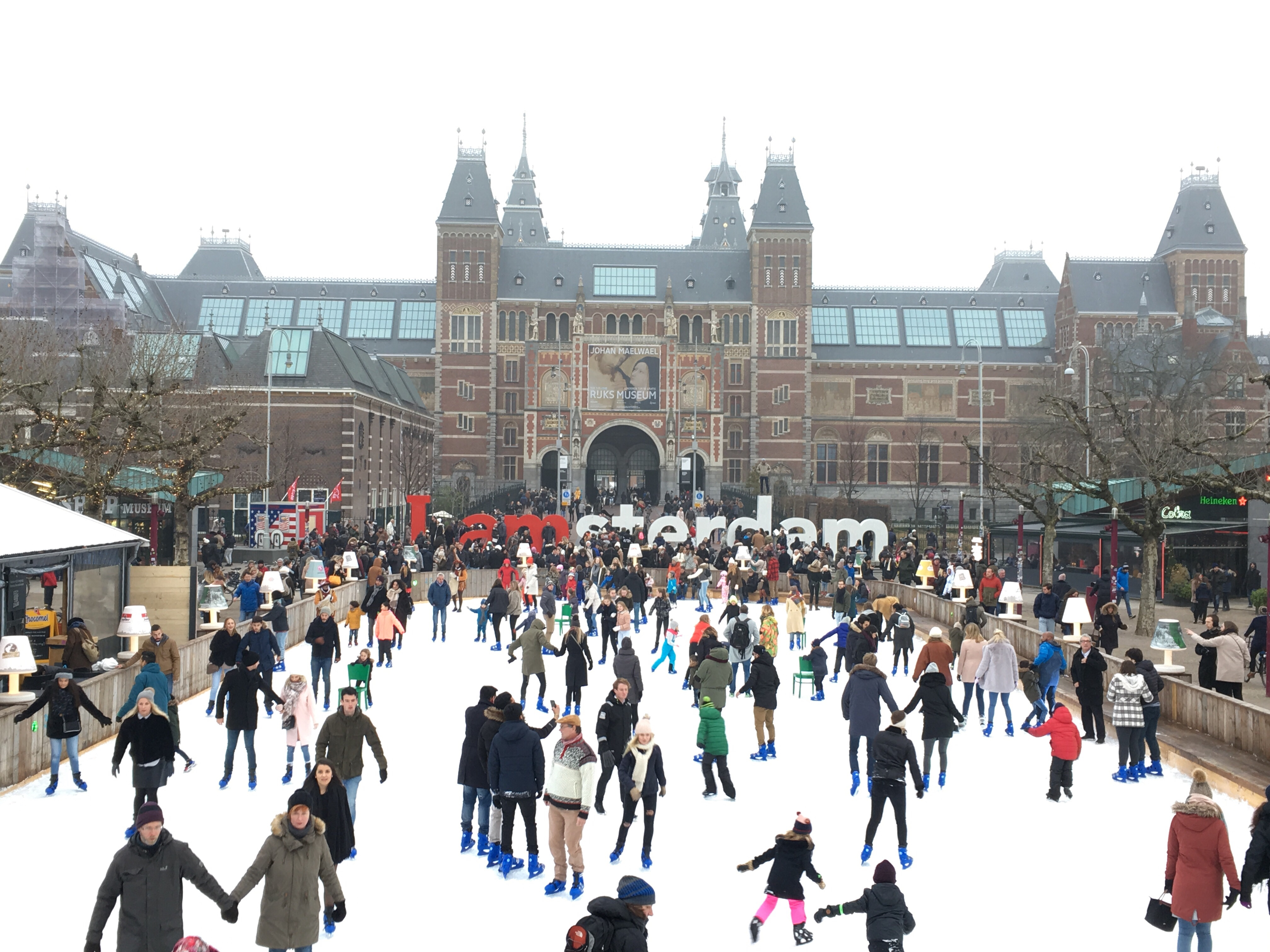 iamsterdam sign in front of the Rijksmuseum and skating rink in front of the square