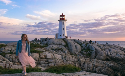 Peggy's Cove Lighthouse with girl posing in dress