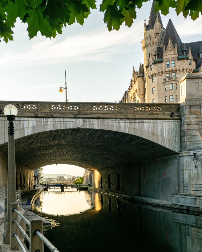 Fairmont Laurier Chateau Laurier and Rideau Canal locks during golden hour