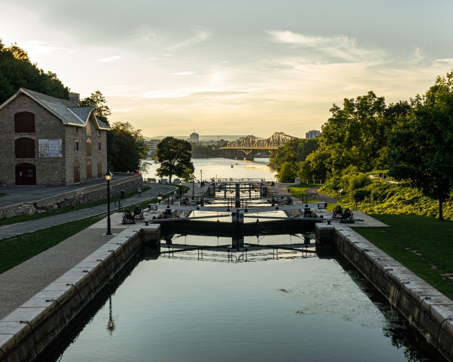 Alexandra Bridge and Rideau Canal locks and Bytown Museum during golden hour in Ottawa Ontario Canada