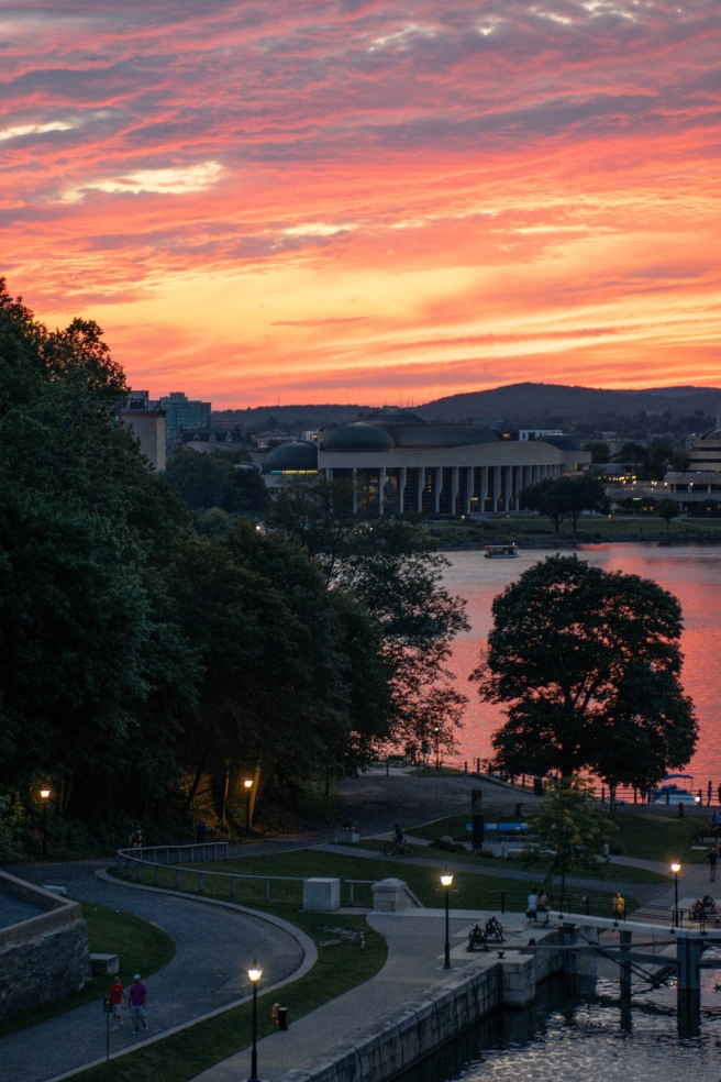 Pink and purple sunset overlooking the Ottawa River and the Museum of History from the Chateau Laurier