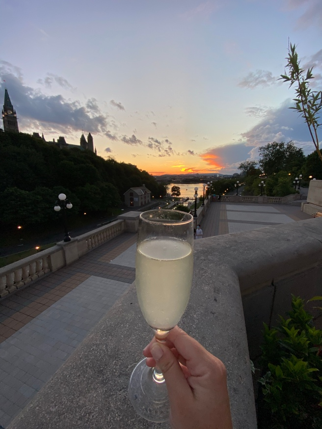 Drink in hand during sunset at La Terrasse Fairmont Laurier Cocktail