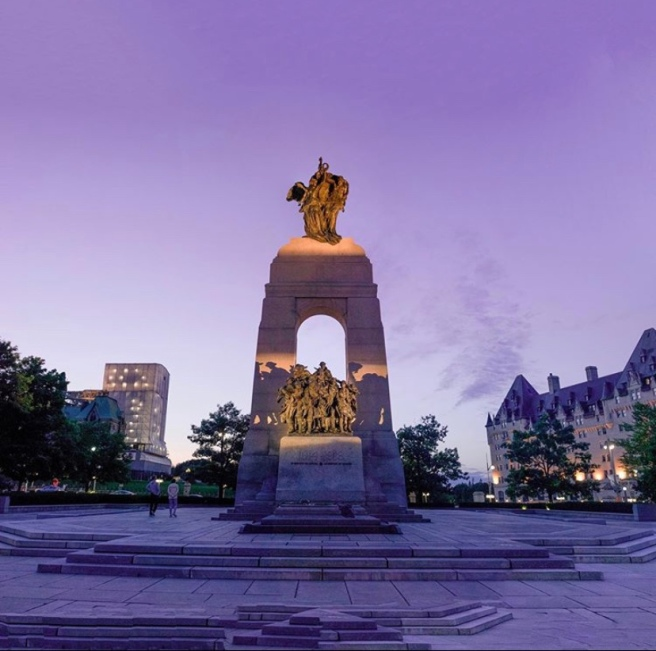 Ottawa Ontario War Memorial at sunset with Fairmont Laurier
