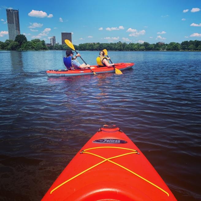 Couples kayak on Dow's Lake in rental kayak on water