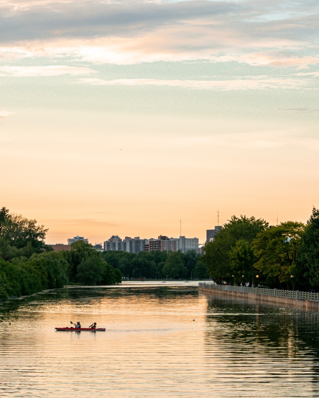 Kayakers on the Rideau Canal at Dow's Lake during a yellow and orange sunset