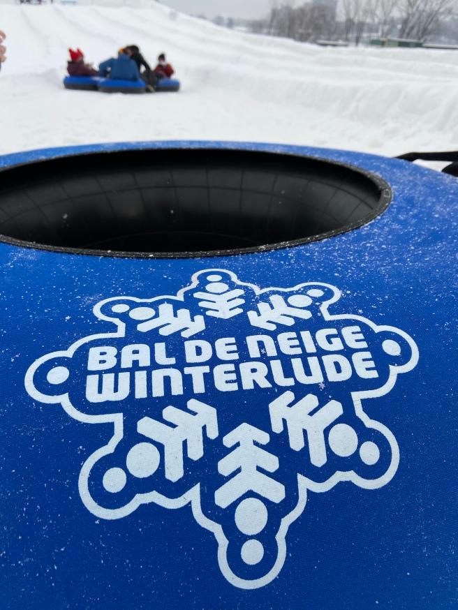 Winterlude tubing down a snow hill in Ottawa Canada
