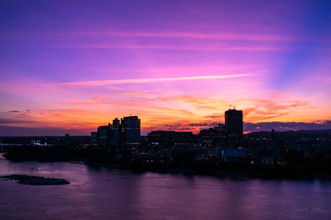 Purple and yellow and orange and red sunset overlooking the Ottawa River