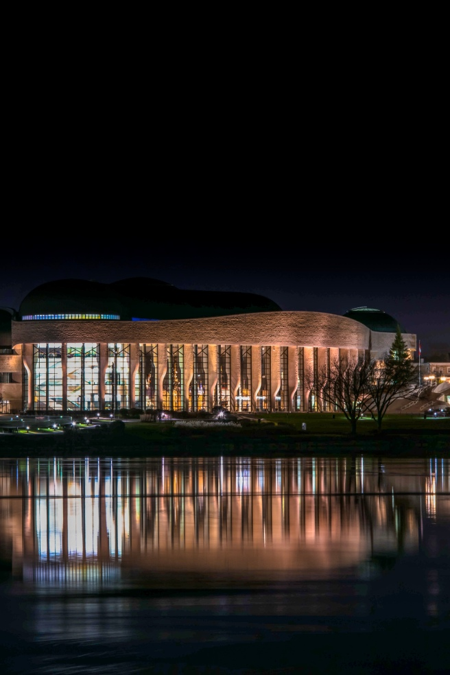 Museum of History at night reflecting on the Ottawa River
