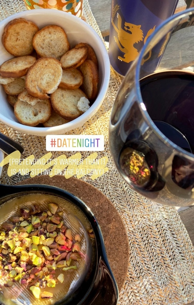 Date night with baked brie and wine at home