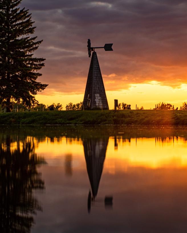 Orange and yellow sunset over Andrew Haydon Park in Ottawa