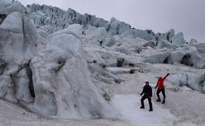 Two woman in hiking boots and helmets on a Glacier Hike in Iceland on Vatnajökull Glacier