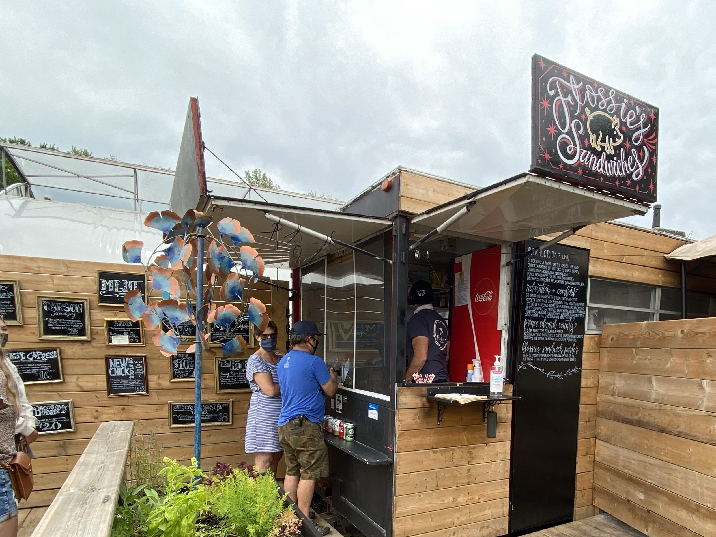 Food truck with menu on chalkboards at Flossie's Sandwich Parlor