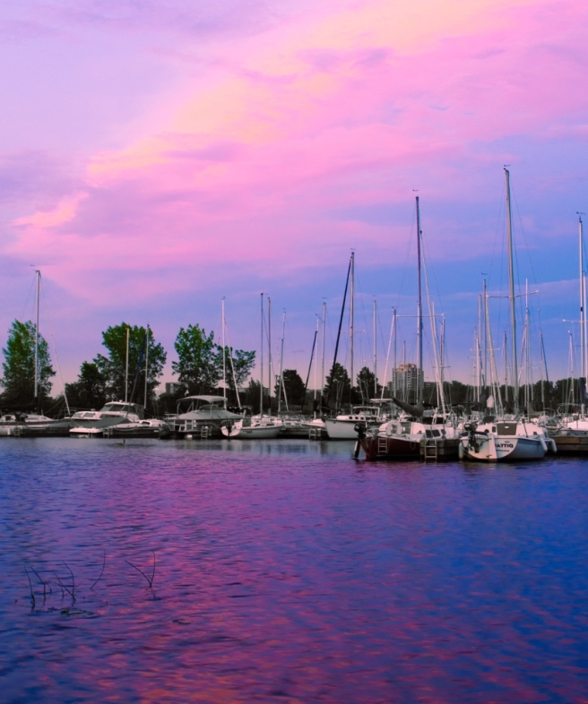 Purple sunrise over a marina