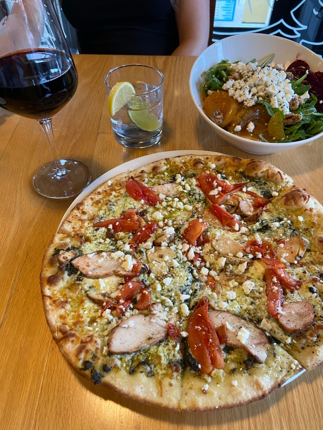 ESCA's Pizza and goat cheese salad
