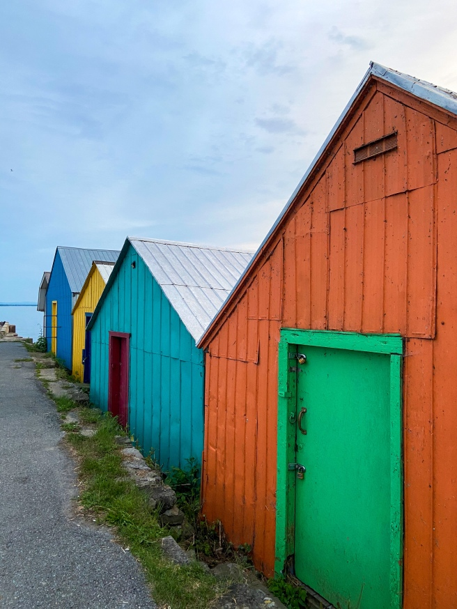 Row of colourful boat houses