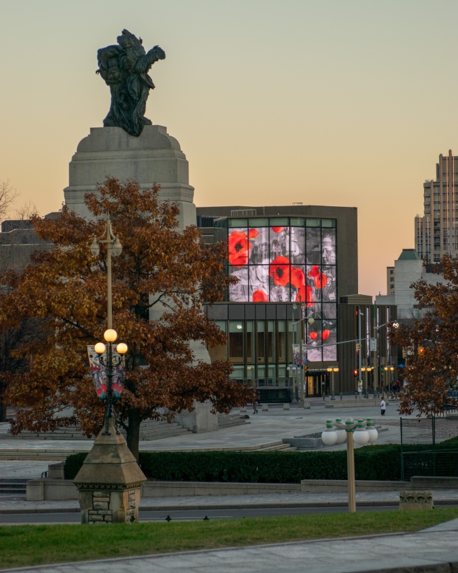 Canadian War Memorial and National Arts Centre with falling poppy video